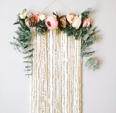 Love, Love, LOVE this sweet, little piece!! If you love peonies, youll be head over heels for this piece! Its like having a feminine little garden hanging on your wall! In my line of these floral design wall hangings, this is a smaller version, perfect for tighter spaces or if you just think the larger sizes are overwhelming. This piece is approx. 30 vertical (from top of flowers to bottom of extensions) and 17 across. A variety of multi-textured yarns hang from a wooden dowel, all in…