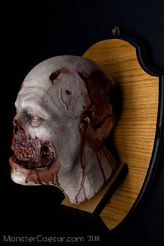 This is a mounted zombie head hunting trophy from artist Andrew Martin of Monster Caesar Studios