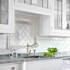 Above a sink or a cooktop, border pieces set off a smaller field of different tile. For this all-white subway-tile backsplash, a floral border surrounds square tile laid in a diamond pattern, helping draw the eye to the sink's period-style fixtures. Photo: Eric Roth | thisoldhouse.com