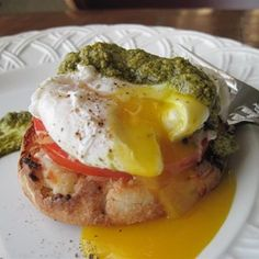 Poached eggs with pestoand fresh tomato is a lighter breakfast inspired by the classic Eggs Benny.  Allrecipes.com