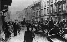 Cracow, Poland, Wagons and pedestrians in the streets of the ghetto.
