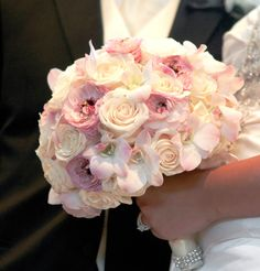 Pink bride bouquet with touches of crystals. #wedding #roses #bride