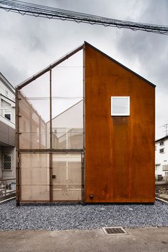 Tokyo house featuring a rusted exterior designed to weather over time.