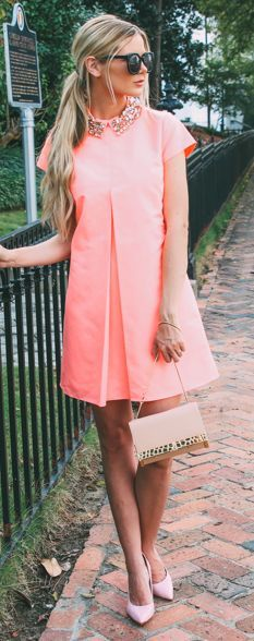 Coral one pleat mini dress with rhinestones collar, golden crocodile bag, pink heels.