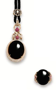 BLACK JADEITE, RUBY, PINK SAPPHIRE AND DIAMOND PENDANT AND MATCHING RING.    The pendant centring on a semi-translucent oval black jadeite cabochon, to a pavé-set brilliant-cut diamond frame, embellished by a decorative surmount composed of circular-cut diamonds and rubies, strung on a black cord; and a matching ring centring on an oval black jadeite cabochon to a stylised mount set with circular-cut diamonds, rubies and pink sapphires; mounted in 18 karat pink gold.