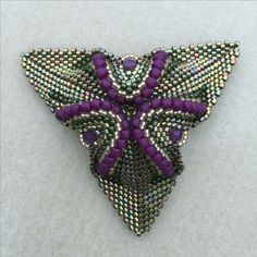 This pendant is an Eridhan Creations pattern.