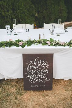 "Elegant sweetheart table idea - greenery table runner + wooden sign with handwritten calligraphy ""I have found the one whom my soul loves"" {Alicia Lucia Photography}"
