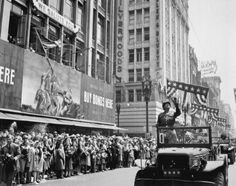 General George S. Patton acknowledging the cheers of the welcoming crowds in Los Angeles during his visit, June 1945