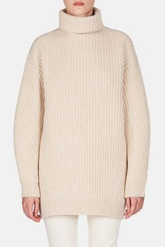 This oversized turtleneck sweater from Acne Studios stands out for its versatile…
