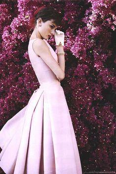 Audrey Hepburn, wearing a pale pink dress