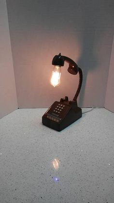 Check out this item in my Etsy shop https://www.etsy.com/listing/589647892/vintage-phone-lamp-desk-lamp-table-lamp