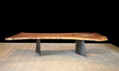 BLACK WALNUT DINING TABLE WITH CURVED BLACKENED STEEL LEGS