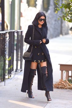 Va va voom! Kylie Jenner in thigh-high, lace-up boots!