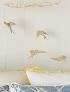 What about a mobile over the dining table instead of a light fixture?  I love these swallows from #blisslivinghome. $130