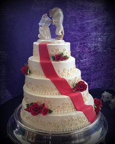 LOVE THIS. Beauty and the Beast wedding cake.