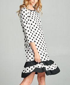 Take a look at this Black & White Polka Dot Ruffle-Hem Shift Dress today!
