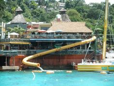 """Jimmy Buffet margaritaville Montego Bay, Jamaica. It has a slide attached to the building that you can ride the goes into the ocean...has """"air trampolines and tubes"""" as well."""