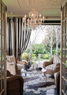 Lovely indoor/outdoor porch, I'm digging those curtains, the chandelier, and the patterned ceiling. Those three little touches really turn this into a lovely indoor/outdoor space. Outdoor Curtains, Outdoor Rooms, Outdoor Living, Outdoor Decor, Indoor Outdoor, Outdoor Fabric, Outdoor Ideas, Porch Curtains, Outdoor Patios