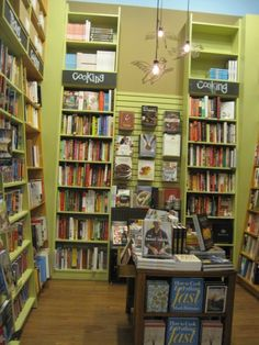 Painted repurposed fixtures are fun with some color at Parnassus Books. The slatwall adds a focal point between tall cases. Book Stands, Display Stands, Store Window Displays, Slat Wall, Bookstores, Milling, Main Street, Buffalo, Repurposed