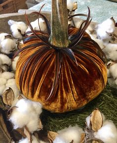 This listing is for Amber Velvet Pumpkins in four sizes made of silk velvet material and real feathers. They are filled with rice and polyester fiberfill to give them a unique shape, weight and appearance. Includes real dried pumpkin stem. These pumpkins are finished as shown in the pictures above and are ready to ship. Large = 10 wide Medium = 6 wide Small = 4 wide Extra Small = 3 wide Genuine Silk Velvet pumpkins handmade with Real Pumpkin Stems. Filled with 100% fluffy ...