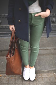 olive green pants + blue coat + brown bag + white sneakers
