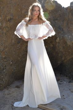 Newest style! Saldana Vintage exclusive. Introductory price of $598! This includes custom sizes. Vintage inspired. This gorgeous dress features huge sheer embroidered mesh ruffle with elastic all arou