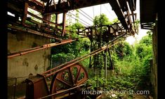 """Inside the Matterhorn-like mountain where the photographer captured this rusted heavy machinery with heavy overgrowth in September 2010. He wrote, """"A coaster ride goes round the outside, while the cable-car goes through."""