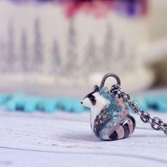 tribal raccoon Totem Jewelry, Miniature raccoon,  raccoon Figurine, Boho Jewelry, ceramic animal jewelry, spirit animal, galaxy jewelry by WildlandsArtistry on Etsy https://www.etsy.com/listing/292224135/tribal-raccoon-totem-jewelry-miniature