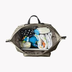 Warm Silver Shimmer Diaper Bag This is our third diaper bag collection. This collection comes in two sizes and has added improvements with a new padded laptop sleeve. An urban minimalistic unisex diaper backpack, functional for every-day use. This backpack has room for everything we believe