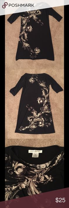 Maggy London Print Shift Dress Slight cowl neck, 1/2 length sleeves, large paisley print on portion of shift dress.  95% polyester, 5% spandex. Dry Clean only. Worn twice and washed twice. No visible damage. Maggy London Dresses
