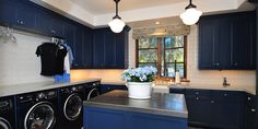 navy laundry room cabinets | stainless steel island countertop