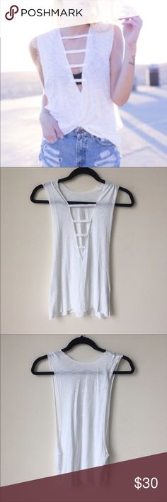 LF Emma and Sam White Caged Front Muscle Tank Top Boutique LF super cute shirt SIZE XS but fits like a S/M. Tags revolve trendy cut out open LF Tops