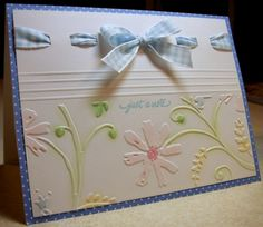 Floral embossed, chalked, ribbon weaving...very pretty