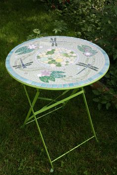 Mosaic round table for inside or outside. €310.00, via Etsy.
