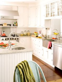 Cottage by the Sea: This Nantucket cottage brings all the wonders of the sea inside with splashes of bright color, lively seaside prints, and practical materials. Veronica Toney. Cottage-Style Kitchen:   Located in the center of the house, the white and stainless steel kitchen is a neutral counterpoint to the color palette of the surrounding rooms. Beaded board around the kitchen island carries the cottage look into the room.