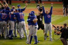"""Photos of the Chicago Cubs Hugging After World Series Win 