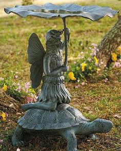 Astride a turtle, a winsome fairy graces your garden carrying a flower umbrella that doubles as a birdbath.