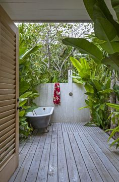For a family compound on Jamaica's west coast, designer Sean Knibb envisioned several small cottages, their own outdoor baths. Photograph by Art Gray. Outdoor Bathtub, Outdoor Bathrooms, Indoor Outdoor, Outdoor Bathroom Inspiration, Outside Showers, Outdoor Showers, Outdoor Spaces, Outdoor Living, Custom Shower Doors