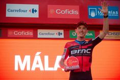 BMC Racing Team's Australian cyclist Rohan Dennis waves on the podium as he celebrates winning the first stage of the 73rd edition of 'La Vuelta' Tour of Spain cycling race, an 8 km individual time trial from Malaga to Malaga, on August 25, 2018. (Photo by JORGE GUERRERO / AFP)        (Photo credit should read JORGE GUERRERO/AFP/Getty Images)