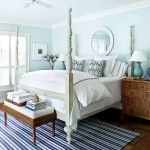 bright and cozy guest bedroom with white