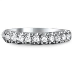 The Etenia Ring from Brilliant Earth ~ This diamond and platinum band features ten gorgeous round diamonds uniquely and individually set in a luxurious curve that drapes the finger in sparkle. A slight taper in the platinum completes this special piece (approx. 0.2 total carat weight).