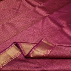 Swirls of bewitching magenta pink old rose come together in the textured body of this #silk #sari. Almost like crystallized raspberry and strawberry syrup frozen together. The simple gold border is made up of diagonal lines while the luscious pink pallu is enmeshed in geometric motifs creating a cherished heirloom sari. Small floral motif are scattered on the magenta pink blouse which looks perfect with the running border. An offering from Sarangi's pretty pinks. Code 390126060.