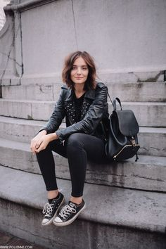 Black studded leather jacket, skinnies & converse (love the stylish backpack) … cool &...