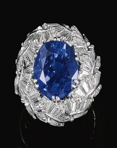VAILLANT AND DUVERNE   A SAPPHIRE AND DIAMOND RING, c1960 ... diamond leaves (Sotheby's)