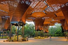 "We're crazy about this gorgeous botanical garden in Medellin, Colombia that was renovated in 2008 by Plan B Architects. The Orquideorama is an organically expanding wooden meshwork of modular ""flower-tree"" structures that weaves its way through the garden's"