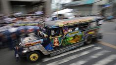 """The Philippines' iconic passenger jeepney, once regarded as Manila's """"King of the Road,"""" is chugging toward change and uncertainty. A remnant of World War II, the gaudily decorated jeepneys evolved from the U.S. military jeeps that American forces left behind after the war. The vehicles..."""