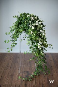 Cascading ivy & tulips for a wedding ceremony aisle.