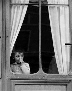mimbeau:  Little boy at the window France 1950 Paul Strand