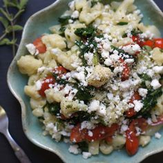 A pasta-like salad that's bursting with classic Greek flavors! Featuring cauliflower instead of pasta, this dish is grain-free and packed with vegetables.