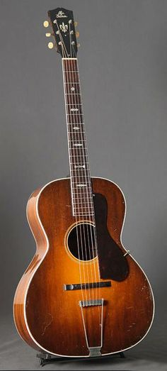 1931 Nick Lucas Special has Brazilian rosewood back and sides. 13th fret neck and a trapeze tailpiece, adjustable bridge and floating pickguard are a feature borrowed from Gibson's archtop line